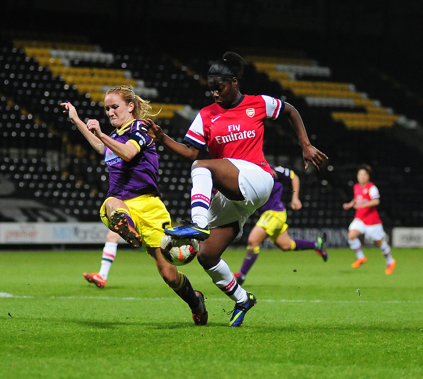 Notts County Ladies' Sophie Bradley&nbsp;vies for possession with Arsenal Ladies' Freda Ayisi&nbsp;<br /> <br /> Photo by Chris Vaughan/CameraSport<br /> <br /> Women's Football - FA Women&rsquo;s Super League 1 - Notts County Ladies v Arsenal Ladies - Wednesday 16th April 2014 - Meadow Lane - Nottingham<br /> <br /> &copy; CameraSport - 43 Linden Ave. Countesthorpe. Leicester. England. LE8 5PG - Tel: +44 (0) 116 277 4147 - admin@camerasport.com - www.camerasport.com