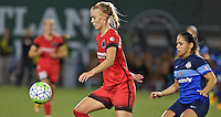 Portland, Oregon - Saturday July 9, 2016: Portland Thorns FC midfielder Dagny Brynjarsdottir (11) receives a pass in front of FC Kansas City midfielder Lo'eau LaBonta (1) during a regular season National Women's Soccer League (NWSL) match at Providence Park.