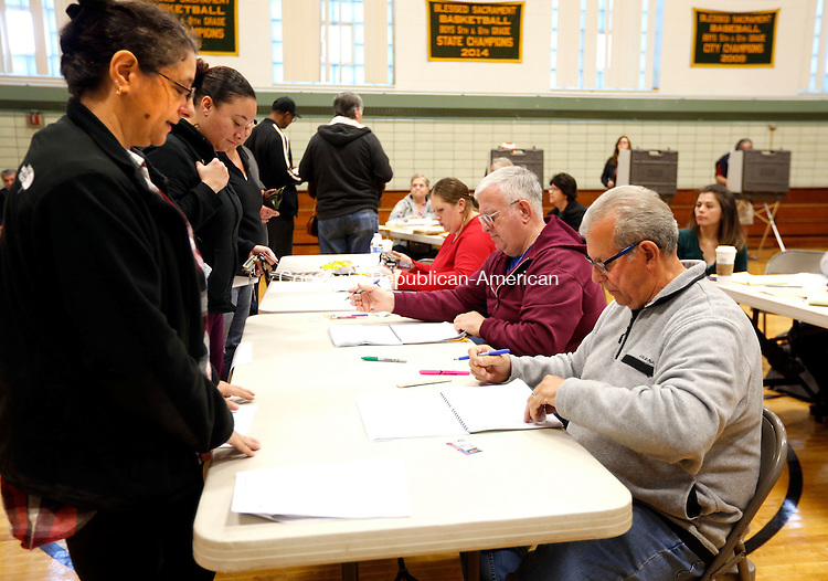 Waterbury, CT- 08 November 2016-110816CM03- Bill Donorfio, right, checks in Terese Richardson of Waterbury at Blessed Sacrament School on Tuesday.   Christopher Massa Republican-American