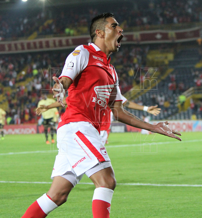 BOGOTA -COLOMBIA- 10-08-2013.Silvio Gonzalez   del Independiente Santa Fe  celebra su gol contra el Itagui   ,  partido correspondiente a la tercera fecha de la  Liga Postob&oacute;n segundo semestre disputado en el estadio Nemesio Camacho El Campin     /  Silvio Gonzalez  of Independiente Santa Fe fights for the ball against of Itagui game in the third round of the League Postob&oacute;n second half played at the Estadio Nemesio Camacho El Campin<br />  Photo: VizzorImage / Felipe Caicedo  / STAFF