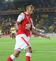 BOGOTA -COLOMBIA- 10-08-2013.Silvio Gonzalez   del Independiente Santa Fe  celebra su gol contra el Itagui   ,  partido correspondiente a la tercera fecha de la  Liga Postobón segundo semestre disputado en el estadio Nemesio Camacho El Campin     /  Silvio Gonzalez  of Independiente Santa Fe fights for the ball against of Itagui game in the third round of the League Postobón second half played at the Estadio Nemesio Camacho El Campin<br />  Photo: VizzorImage / Felipe Caicedo  / STAFF