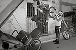 Havana, Cuba: Bicitaxi repairs on the street