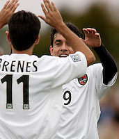 Pablo Brenes of the MetroStars celebrates scoring the first goal of the game with teammate Sergio Galvan Rey. The MetroStars defeated the Chicago Fire 2-0 during the inaugural Hall of Fame game on Monday October 11, 2004 at At-A-Glance Field at the National Soccer Hall of Fame and Museum, Oneonta, NY..