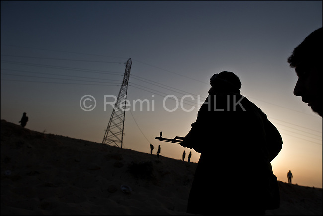© Remi OCHLIK/IP3 -  Benghazi March 25, 2011 - Opposition fighters launch in the end of the day the last assault against  the loyalist forces still hide in Ajdabyia