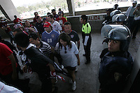 United States Men's National team fans enter their seating area in Azteca stadium under police escort. The United States Men's National Team played Mexico in a CONCACAF World Cup Qualifier match at Azteca Stadium in, Mexico City, Mexico on Wednesday, August 12, 2009.