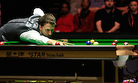 Judd Trump watches the red sink into the pocket during the Dafabet Masters Quarter Final 2 match between Judd Trump and Neil Robertson at Alexandra Palace, London, England on 15 January 2016. Photo by Liam Smith / PRiME Media Images.
