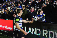 George Ford of Bath Rugby hands a signed ball to a supporter after the match. Aviva Premiership match, between Bath Rugby and Saracens on April 1, 2016 at the Recreation Ground in Bath, England. Photo by: Patrick Khachfe / Onside Images