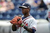 Shortstop Ozhaino Albies (7) of the Rome Braves warms up before a game against the Greenville Drive on Sunday, June 14, 2015, at Fluor Field at the West End in Greenville, South Carolina. Rome won, 5-2. (Tom Priddy/Four Seam Images)