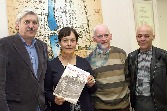"Sean Corcoran, Eddie Quinn and Brendan Matthews present Virginia Wright with a copy of Brendan Matthews's book ""Tower of Strenght"" when she came to discuss her relative Thomas Charles Wright who founded the Ecuadorian Naval School...Photo NEWSFILE/Jenny Matthews.(Photo credit should read Jenny Matthews/NEWSFILE)....This Picture has been sent you under the condtions enclosed by:.Newsfile Ltd..The Studio,.Millmount Abbey,.Drogheda,.Co Meath..Ireland..Tel: +353(0)41-9871240.Fax: +353(0)41-9871260.GSM: +353(0)86-2500958.email: pictures@newsfile.ie.www.newsfile.ie.FTP: 193.120.102.198."
