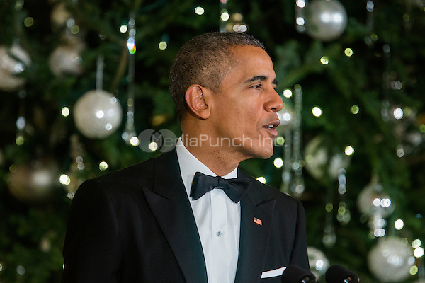 United States President Barack Obama is seen in the East Room of the White House hosting the Kennedy Center Honorees Reception hours before delivering a rare, primetime address to the nation about the ongoing terror crisis in the White House in Washington, DC, USA, 06 December 2015. This is only the third time that President Obama has spoken to the nation live from the Oval Office.  The 2015 Kennedy Center honorees are: singer-songwriter Carole King, filmmaker George Lucas, actress and singer Rita Moreno, conductor Seiji Ozawa, and actress and Broadway star Cicely Tyson.  <br /> Credit: Jim LoScalzo / Pool via CNP/MediaPunch