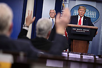 United States President Donald J. Trump speaks during a press conference with members of the coronavirus task force in the Brady Press Briefing Room of the White House on March 24, 2020 in Washington, DC. At left is US Vice President Mike Pence.<br /> Credit: Oliver Contreras / Pool via CNP/AdMedia