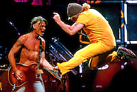 Rick Wilson Photo--9/16/04--Guitarist Eddie Van Halen (left) screams out as lead singer Sammy Hagar (right) does his best to get airborne during the song Jump during Van Halen's concert at Jacksonville Veterans Memorial Arena Thursday night September 16, 2004 in Jacksonville, Fl.