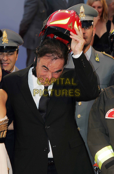 """OLIVER STONE.The 63rd International Venice Film Festival """"World Trade Center"""" Premiere held at Palazzo Del Cinema, Venice, Italy. .September 1st, 2006.Ref: OME.half length black suit jacket red helmet hat.www.capitalpictures.com.sales@capitalpictures.com.©Omega/Capital Pictures."""