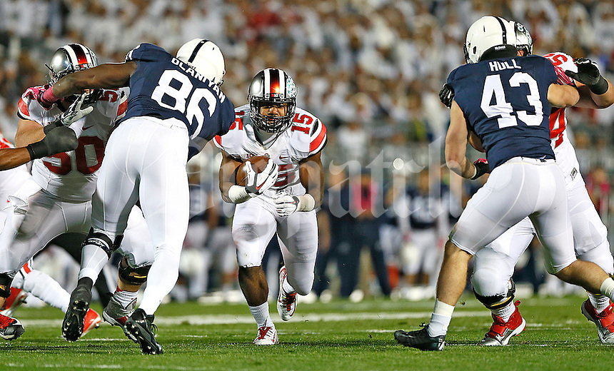 Ohio State Buckeyes running back Ezekiel Elliott (15) runs against Penn State Nittany Lions defensive end C.J. Olaniyan (86) and Penn State Nittany Lions linebacker Mike Hull (43) at Beaver Stadium on October 25, 2014.  (Chris Russell/Dispatch Photo)
