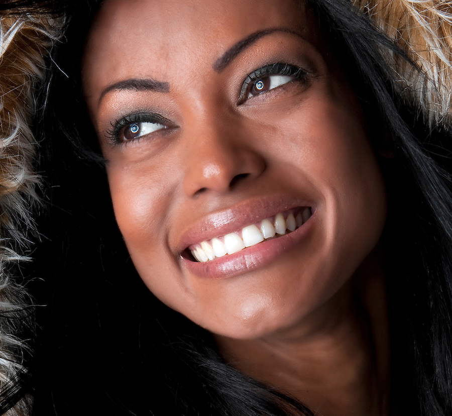 Portrait of young hispanic woman smiling very happy.