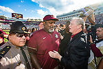 Florida State interim head coach Odell Haggins talks with Florida State president John Thrasher after an NCAA college football game against Louisiana Monroe in Tallahassee, Fla., Saturday, Dec. 2, 2017. Florida State defeated Louisiana Monroe.  (AP Photo/Mark Wallheiser)