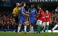 Wednesday 09 January 2013<br /> Pictured: (L-R) Anthony Taylor (Referee), David Luiz, Ramires, Pablo Hernandez.<br /> Re: Capital One Cup semifinal, Chelsea FC v Swansea City FC at the Stamford Bridge Stadium, London.