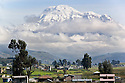 Located in the Andean Range, Chimborazo is Ecuador's highest peak <br /> (20,565 feet). This inactive volcano towers above indigenous communities near the city of Riobamba. Due to the earth's bulge at the equator, Chimborazo's summit is the furthest point from the center of the earth.<br /> <br /> Clouds usually obscure the behemoth volcano, but on this day we were able to pull over on the Pan-American Highway to take in the view from the south.The drive to Riobamba from the village of San Bernardo usually takes about one and a half hours. San Bernardo is located in a small valley, roughly 10,500 feet above sea level.