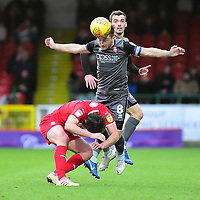 Lincoln City's Lee Frecklington vies for possession with Swindon Town's Jak McCourt<br /> <br /> Photographer Andrew Vaughan/CameraSport<br /> <br /> The EFL Sky Bet League Two - Swindon Town v Lincoln City - Saturday 12th January 2019 - County Ground - Swindon<br /> <br /> World Copyright &copy; 2019 CameraSport. All rights reserved. 43 Linden Ave. Countesthorpe. Leicester. England. LE8 5PG - Tel: +44 (0) 116 277 4147 - admin@camerasport.com - www.camerasport.com