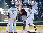 Reno Aces' Randy Ruiz is greeted at the plate after hitting a three-run homer during a minor league baseball game against the Tacoma Rainiers in Reno, Nev., on Wednesday, May 30, 2012. The Aces won 13-5..Photo by Cathleen Allison
