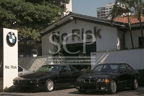 "Sao Paulo, Brazil. ""No Risk"" armoured motor car and security service with two armoured BMW cars; Jardins district."