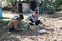 Grace preparing nopales. Breakfast with Grace Garcia and her family, Monte Alto, San Miguel La Labor, Estado de Mexico,  Mexico