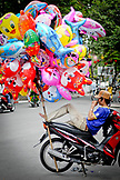 VIETNAM, Ho Chi Minh, Saigon, Holiday, Man Leaning on Motorcycle, with Ballons