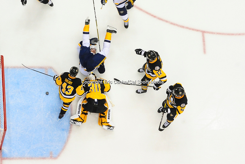 May 29, 2017: Nashville Predators center Filip Forsberg (9) lands on his back after falling over Pittsburgh Penguins goalie Matt Murray (30) during game one of the National Hockey League Stanley Cup Finals between the Nashville Predators  and the Pittsburgh Penguins, held at PPG Paints Arena, in Pittsburgh, PA. Pittsburgh defeats Nashville 5-3 in regulation time.  Eric Canha/CSM