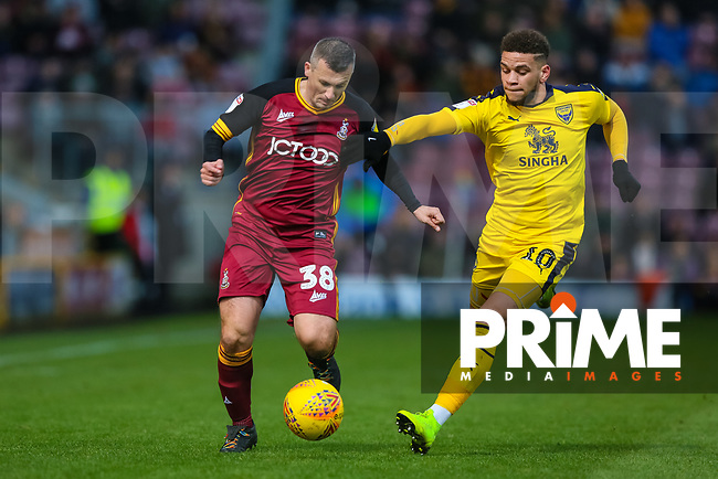 Paul Caddis of Bradford City and Marcus Rowe of Oxford during the Sky Bet League 1 match between Bradford City and Oxford United at the Northern Commercial Stadium, Bradford, England on 24 November 2018. Photo by Thomas Gadd.