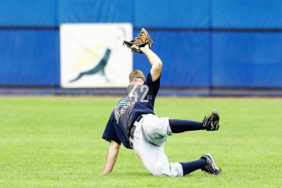 10 September 2011: Michael Duursma of Vaessen Pioniers falls as he catches the ball during game 4 of the 2011 Holland Series won 6-2 by L&D Amsterdam Pirates over Vaessen Pioniers, in Amsterdam, Netherlands.