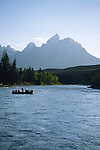 A group of rafters float down the Snake River in Grand Teton National Park, Jackson Hole, Wyoming.