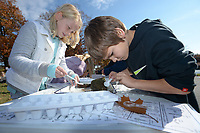 NWA Democrat-Gazette/ANDY SHUPE<br /> Brandon Hill (right) and Madison Wantland, both 10-year-old fifth-graders at Lincoln Middle School, collect macro invertebrates Wednesday, Nov. 7, 2018, at Dot Neely's booth for the Beaver Water District during Forest Appreciation Day sponsored by the Arkansas Forestry Association Education Foundation at Lake Wedington in Washington County.