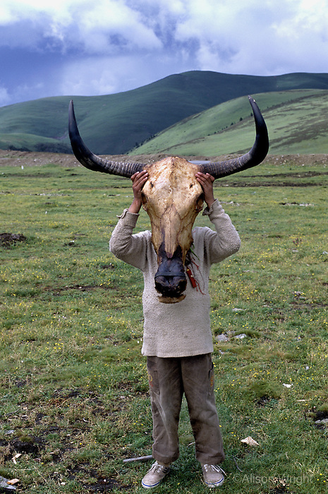 Boy wearing cowskull, Litang, Kham, eastern Tibet, 2005