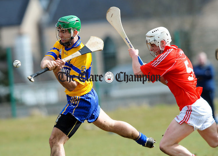 Caimin Morey of Sixmilebridge shoots goalward chased by Jason Greene of Crusheen during their U-21 A hurling quarter final at Clarecastle. Photograph  by John Kelly.