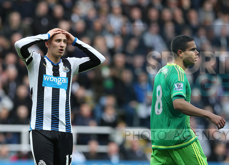Newcastle United's captain Jonjo Shelvey, left, stands dejected after failing to score during the Barclays Premier League match at St James' Park Stadium. Photo credit should read: Scott Heppell/Sportimage