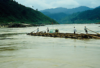 Traveling down the Yangtze in China on a home made raft of logs.