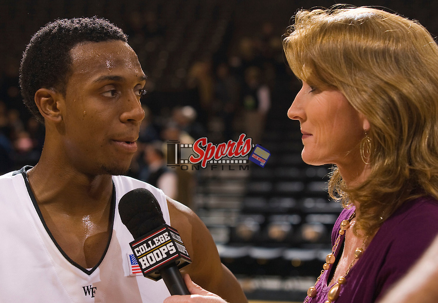 Ishmael Smith #10 of the Wake Forest Demon Deacons is interviewed by Fox Sports Net reporter Debbie Antonelli following the game against the North Carolina State Wolfpack at the Lawrence Joel Veterans Memorial Coliseum December 20, 2009, in Winston-Salem, North Carolina.  The Demon Deacons defeated the Wolfpack 67-59.  Photo by Brian Westerholt / Sports On Film