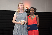 Waruguru Waithira '19, recipient of the Mortar Board Award for the Promotion of Multiculturalism. Chloe Zeller '19 presents.<br /> Graduating seniors, faculty and staff enjoy Class Day and Senior Brunch in Rush Gym, Friday, May 17, 2019.<br /> (Photo by Marc Campos, Occidental College Photographer)