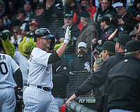 White Sox catcher Tyler Flowers is congratulated by teamates after his fifth inning home run