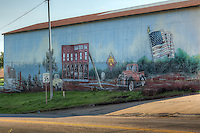 Mural on Route 66 on the south side of town in Chandler Oklahoma.  The mural show important historical elements of Chandler.