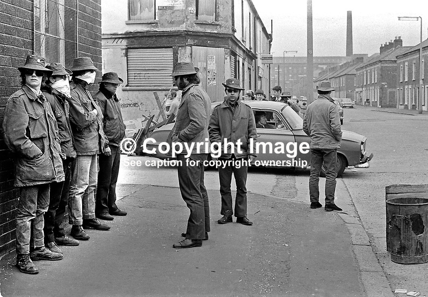 """Ulster Defence Association (UDA) members """"on duty"""" on a street corner in the Woodvale district of Belfast where they had erected barricades and were carrying out searches of people passing through the area.. The UDA were creating Protestant No Go areas similar to those in Republican enclaves. NI Troubles. Ref: 19720514002...Copyright Image from Victor Patterson, 54 Dorchester Park, Belfast, UK, BT9 6RJ..Tel: +44 28 9066 1296.Mob: +44 7802 353836.Voicemail +44 20 8816 7153.Skype: victorpattersonbelfast.Email: victorpatterson@mac.com.Email: victorpatterson@ireland.com (back-up)..IMPORTANT: If you wish to use this image or any other of my images please go to www.victorpatterson.com and click on the Terms & Conditions. Then contact me by email or phone with the reference number(s) of the image(s) concerned."""