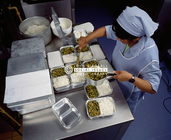 Meals on Wheels for Asian clients, preparing curry UK