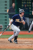 Tyler Baar (23) of the Toledo Rockets follows through on his swing against the Virginia Tech Hokies at The Ripken Experience on February 28, 2015 in Myrtle Beach, South Carolina.  The Hokies defeated the Rockets 1-0 in 10 innings.  (Brian Westerholt/Four Seam Images)