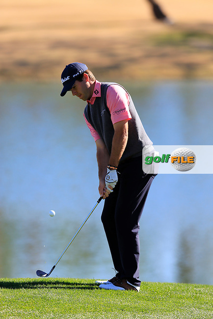 Ben Martin (USA) chips onto the 18th green during Saturday's Round 3 of the 2017 CareerBuilder Challenge held at PGA West, La Quinta, Palm Springs, California, USA.<br /> 21st January 2017.<br /> Picture: Eoin Clarke | Golffile<br /> <br /> <br /> All photos usage must carry mandatory copyright credit (&copy; Golffile | Eoin Clarke)
