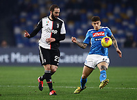 26th January 2020; Stadio San Paolo, Naples, Campania, Italy; Serie A Football, Napoli versus Juventus; Gonzalo Higuain of Juventus plays the ball before contact from Di Lorenzo of Napoli