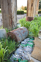 """After The Fall"" by Jack Chandler at Late Show Gardens with recycled plastic bottles and 55 gallon drum"