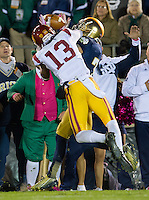 Wide receiver TJ Jones (7) manages to grab a TD pass as USC Trojans cornerback Kevon Seymour (13) defends in the second quarter.