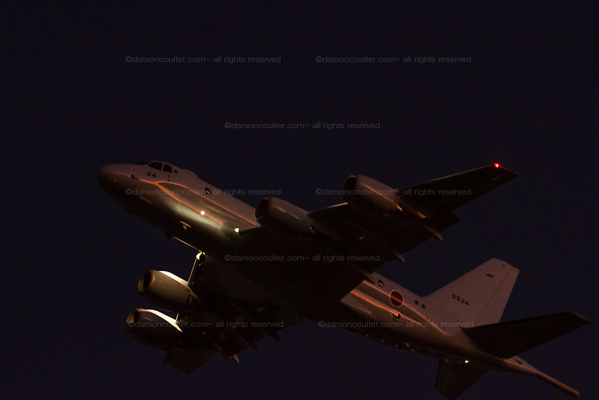A Kawasaki P1 Maritime patrol aircraft with the Japanese Maritime  Self Defence Force (JMSDF) flying over Kanagawa at dusk. Tsuruma, Kanagaawa, japan. Wednesday December 4th 2019