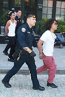 NEW YORK, NY - AUGUST 10: Three men run away from police and later two got arrested and one got away on Greenwich and Vestry Streets on August 10, 2017 in New York City. Credit: DC/Media Punch