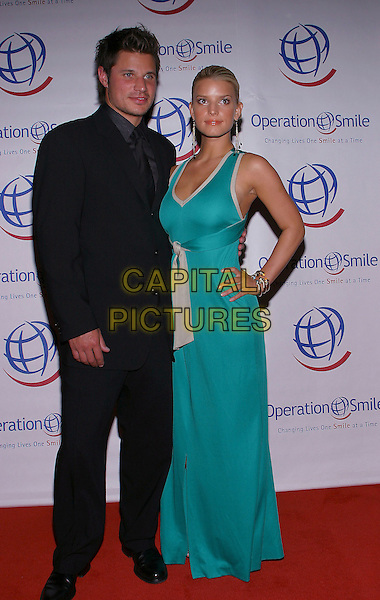 NICK LACHEY & JESSICA SIMPSON.Operation Smiles - 3rd Annual Los Angeles Gala held at the Beverly Hilton Hotel. .21 September, 2004.full length, black suit, green dress, knotted, tied, married, celebrity couple, husband, wife.www.capitalpictures.com.sales@capitalpictures.com.© Jacqui Wong/AdMedia/Capital Pictures.